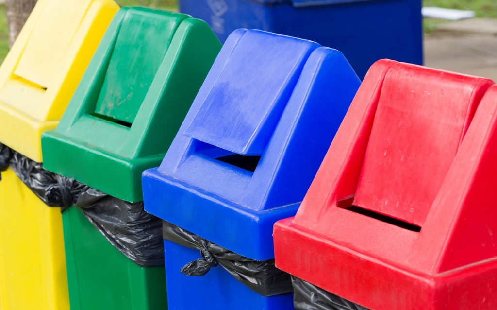Four coloured recycling bins